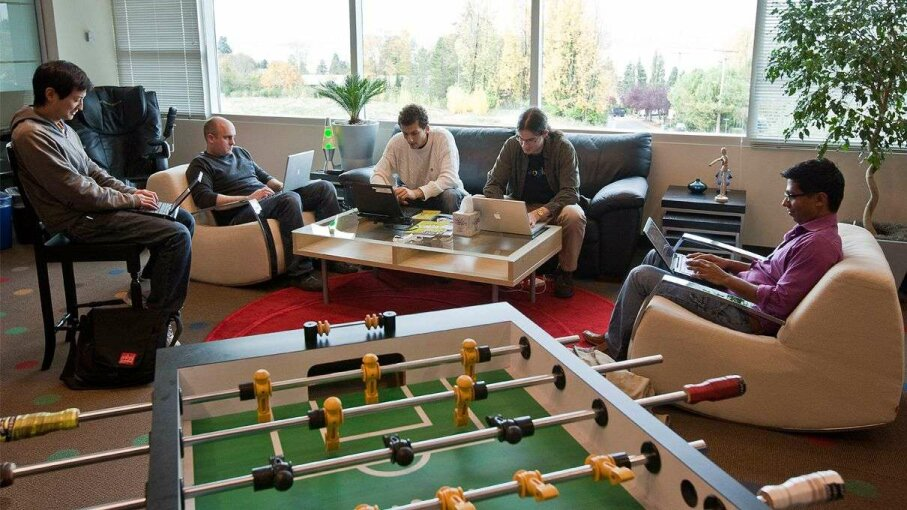 Google software engineers work in a room with a view and an unused foosball table at their Kirkland, Washington office.  Other Google amenities include a gym, soda fountain and rock climbing wall. Stephen Brashear/Getty Images