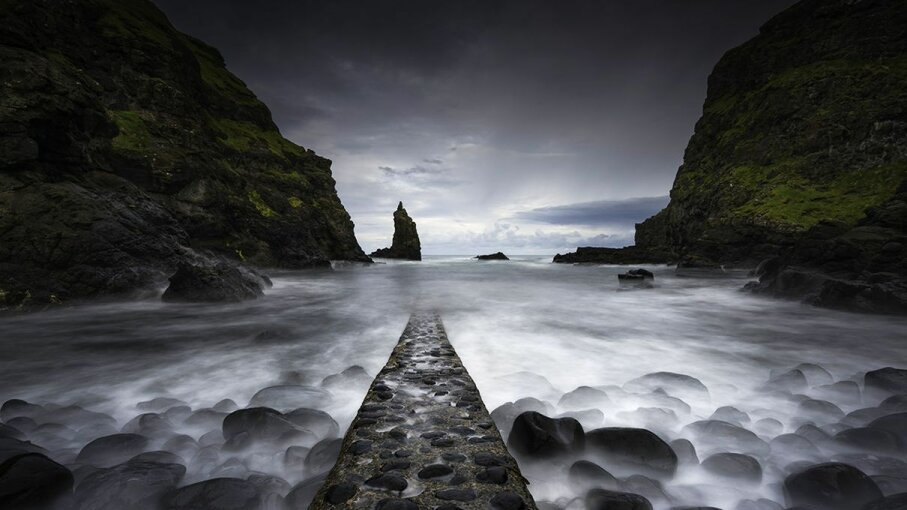 The ruins of a jetty at Port Coon in Ulster, Northern Ireland, near the mysterious geological formation known as the Giant's Causeway. Daniel Bosma/Getty Images