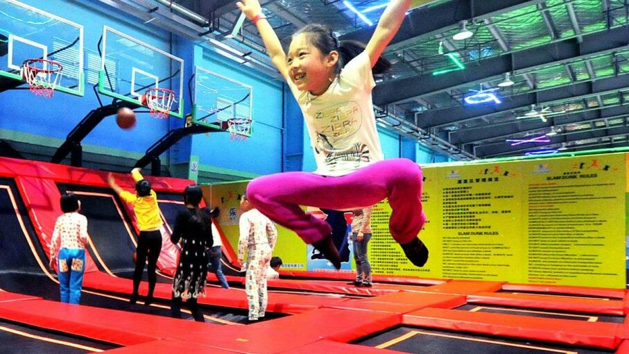A little girl jumps for joy at China's largest trampoline park in Shanghai. A new study highlighted the severity of injuries sustained at these parks. VCG/VCG via Getty Images