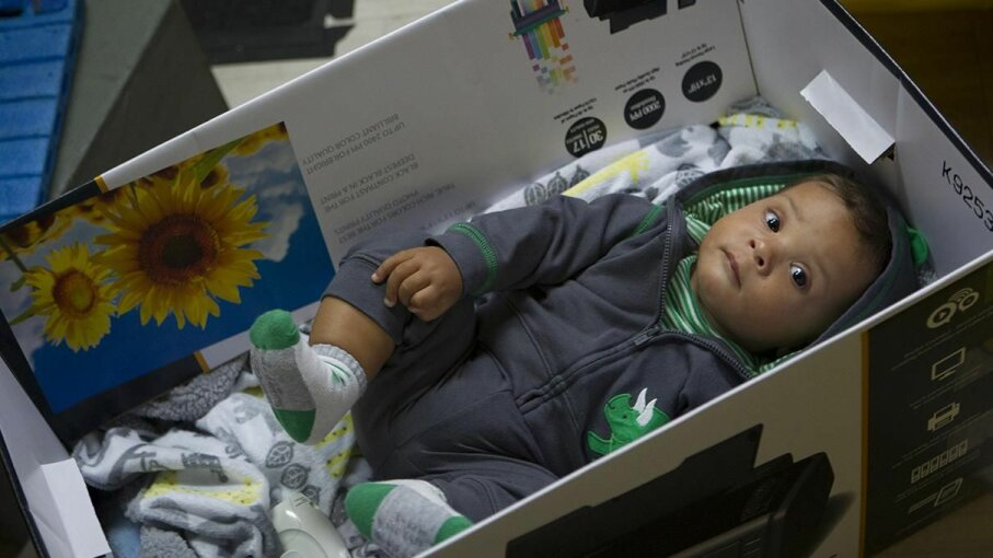 Baby Leo hangs out in a box on the set of The Mindy Project. Thats not an actual baby box like the ones Finland hands out, but the real thing isnt too different. John Fleenor/Universal Television/NBCU Photo Bank via Getty Images