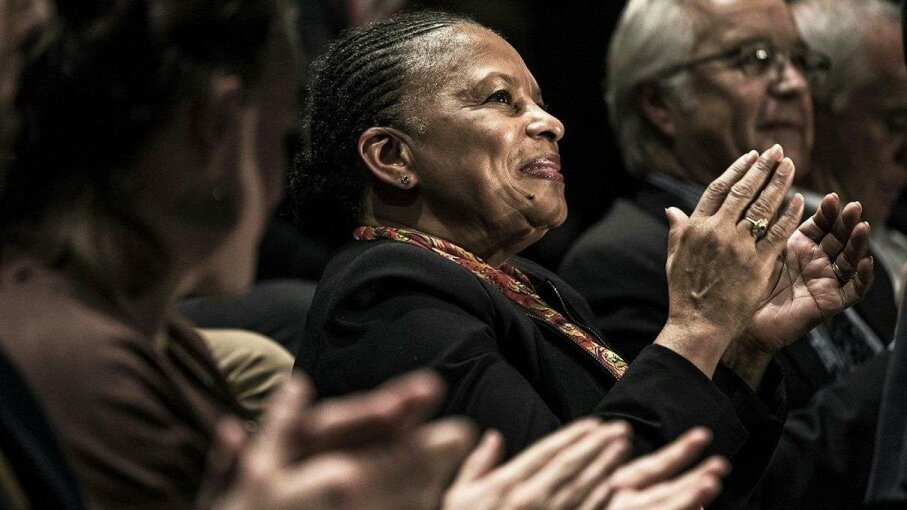 French Justice minister Christiane Taubira applauds during a 2015 campaign rally. Jeff Pachoud/AFP/Getty Images