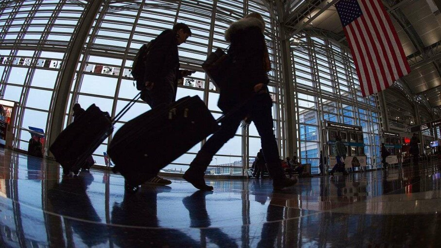 Travelers at Ronald Reagan National Airport walk to a security checkpoint prior to traveling. PAUL J. RICHARDS/AFP/Getty Images