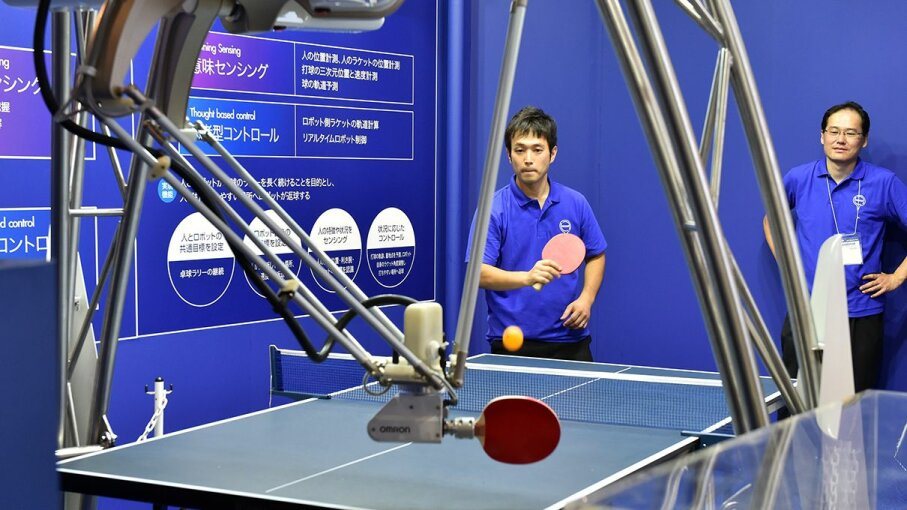 A pingpong robot, created by electronics company Omron, takes on its human competitor. YOSHIKAZU TSUNO/AFP/Getty Images
