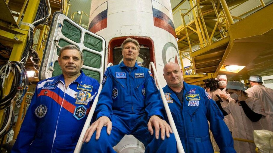 Cosmonauts Mikhail Kornienko, left, and Gennady Padalka of the Russian Federal Space Agency (Roscosmos), and NASA Astronaut Scott Kelly, right, pose for a photograph on the stairs leading into the Soyuz TMA-16M spacecraft during the final check of the ... NASA/Bill Ingalls