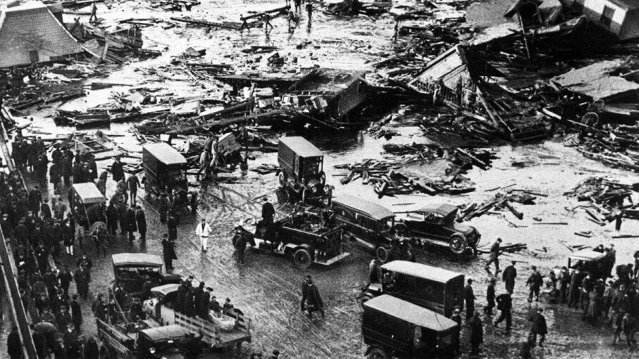 "A detail of an image printed in ""The Boston Globe"" showing the aftermath of a disastrous 1919 industrial spill. Boston Globe/Getty Images"