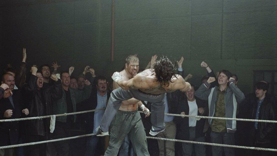 "Brad Pitt is photographed boxing with Scott Welch during the filming of  the Guy Ritchie film ""Snatch."" Daniel Smith/Getty Images"