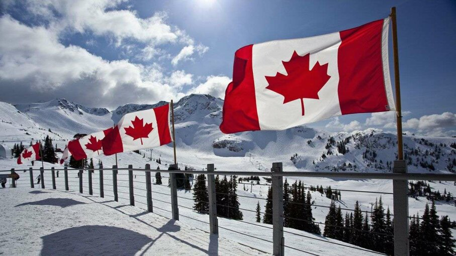 Canadian flags fly at the Roundhouse, Whistler Blackcomb Ski Resort, Whistler, B.C., Canada. Whistler Blackcomb is the largest ski resort in North America. Stuart Dee/Getty Images