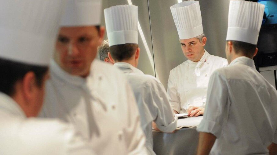 Top chef Benoit Violier (second from right) and his brigade working at the Restaurant de l'Hotel de Ville in Switzerland. The restaurant reopened two days after Violier's apparent suicide sent shock waves through the culinary world. ALAIN GROSCLAUDE/AFP/Getty Images