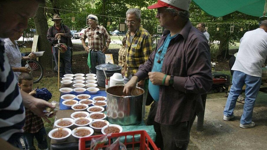 Collinwood Kid serves mulligan stew with park district employees at a 2007 hobo gathering at Deep Lock Quarry near Akron, Ohio. While the glory days of freight trains have long passed in America, there remains a loyal contingent of hobos and wannabes. CHUCK BOWEN/AFP/Getty Images