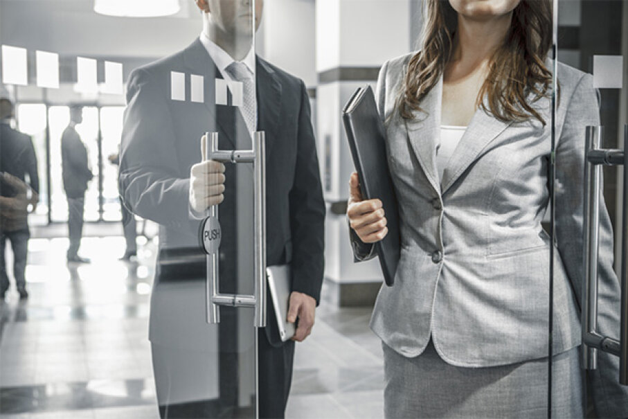 Chivalry can be nice, but is not necessary in a business situation. John Fedele/Blend Images/Getty Images