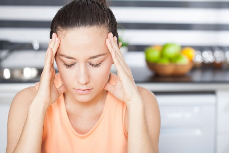 Migraines can be debilitating, and can come with an array of unpleasant symptoms including nausea and light sensitivity.  © eternalcreative/iStockphoto
