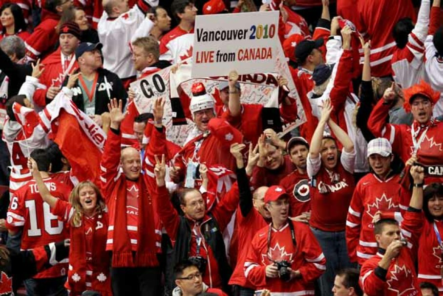 Canada fans cheer on their team during the ice hockey men's gold medal game in Vancouver between the USA and Canada -- which Canada won. Jamie Squire/Getty Images