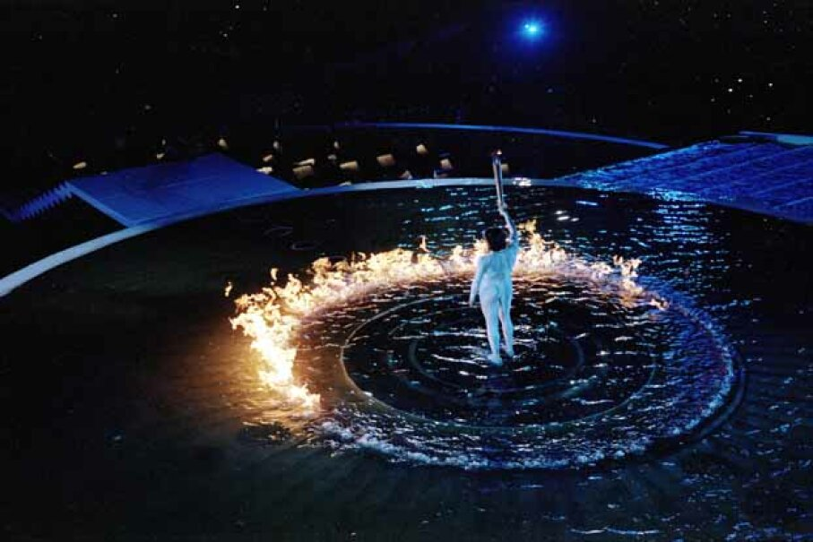 Cathy Freeman of Australia lights the cauldron with the Olympic flame during the opening ceremony of the Sydney Olympics. Freeman was the first torch bearer to also win a gold medal during the Olympics. Ben Elters/Allsport AUS /Allsport /Getty Images