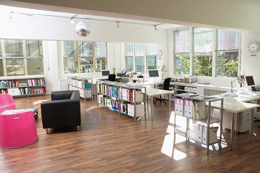 This office has some moveable furniture that can be shifted for private meetings. © Corbis