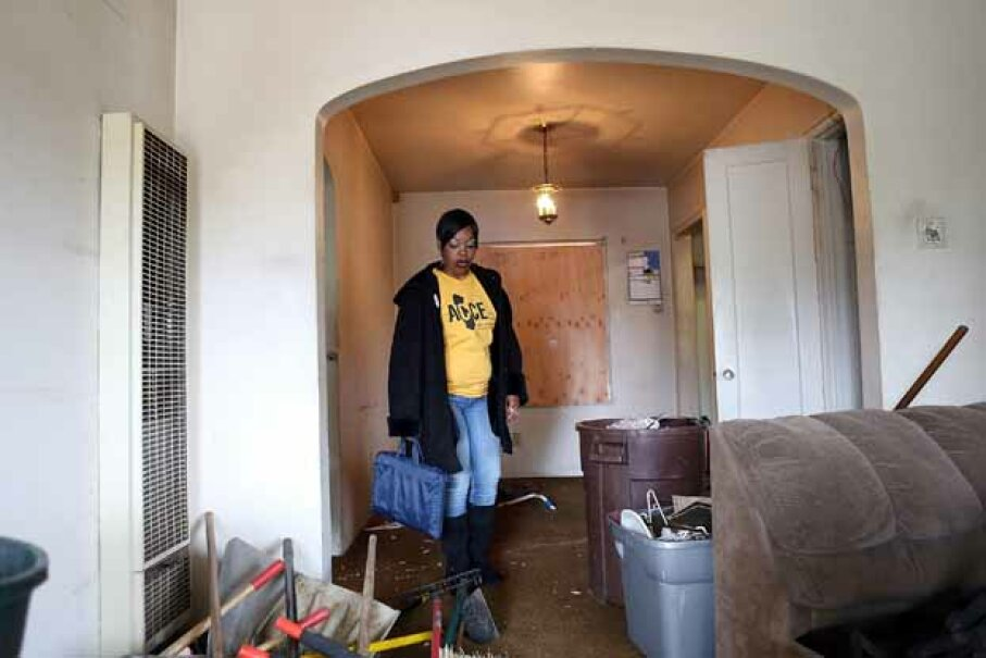 Marquita Ealy of the Richmond, California chapter of the Alliance of Californians for Community Empowerment (ACCE) tours a foreclosed home. Foreclosure is one of the risks you take if you buy a home before you are ready. Justin Sullivan/Getty Images