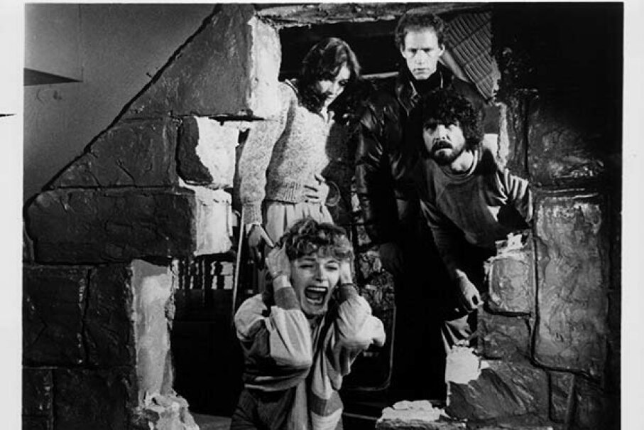 Helen Shaver screams with fear while (L-R) Margot Kidder, Michael Sacks and James Brolin look through the broken wall in a scene from the 1979 film 'The Amityville Horror.' Brolin and Kidder portrayed George and Kathy Lutz. Twentieth Century Fox Film Corporation/Getty Images