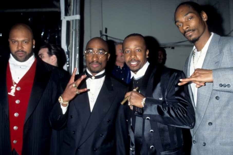 Suge Knight, Tupac Shakur, M.C. Hammer and Snoop Dogg posing at the 23rd Annual American Music Awards on Jan. 29, 1996. Kevin Mazur Archive/WireImage/Getty Images