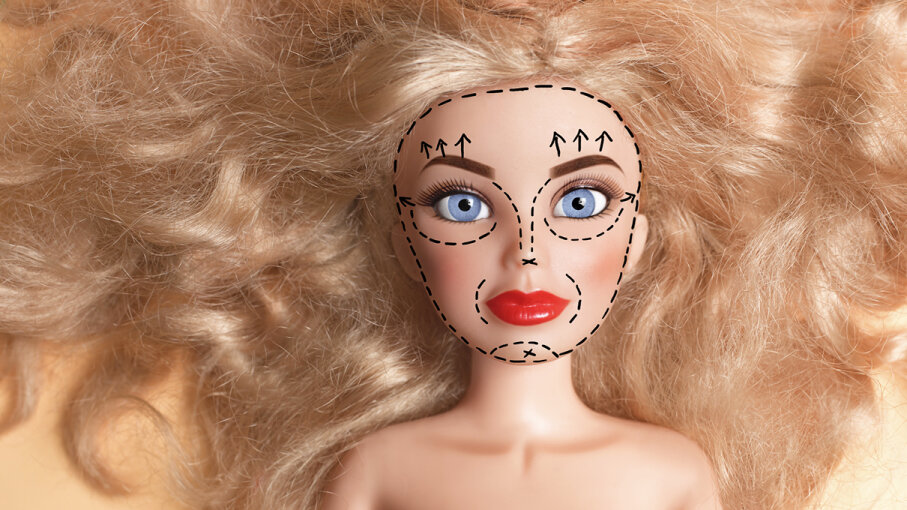 Doll with marker outline on face for plastic surgery