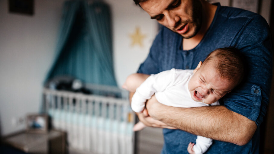 dad with crying baby
