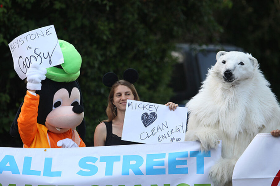 Ileene Anderson, dressed as Goofy, Valeria Love and Andrea Weber, dressed as a polar bear called Frostpaw, rally against the Keystone XL Canada-to-Texas pipeline project in Bel-Air, California in 2014. David McNew/Getty Images