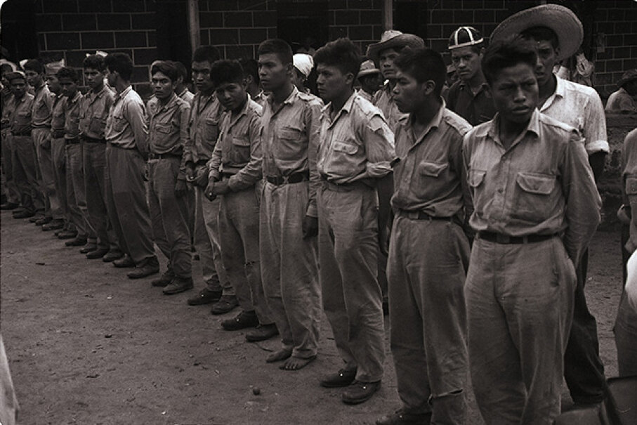 """This 1954 photo shows the first group of prisoners taken in Guatemala in the battle for Chiquimula by anti-Communist liberation forces. The impetus for this """"revolution"""" came in large part from United Fruit Company. © Bettmann/CORBIS"""
