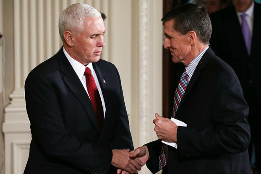 Vice President Mike Pence (L) shakes hands with National Security Adviser Michael Flynn on Feb. 10, 2017. By Feb. 14, Flynn had resigned after some undisclosed conversations with Russia's ambassador to the U.S. came to light.  Mario Tama/Getty Images