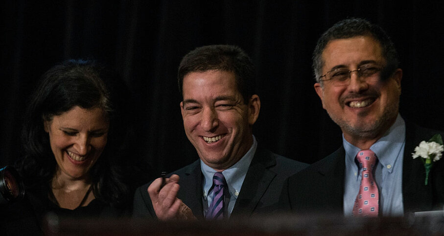 Laura Poitras (L), Glenn Greenwald (C), and Barton Gellman (R), who all worked with National Security Agency leaker Edward Snowden, wait to accept the George Polk Award for national security reporting on April 11, 2014, in New York City. Andrew Burton / Getty Images