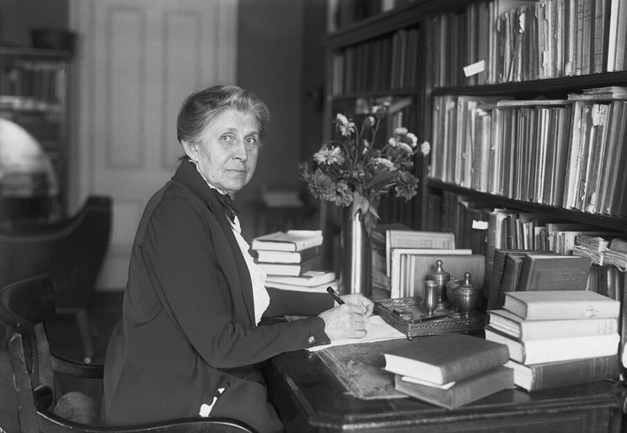 "Ida M. Tarbell is shown at her desk in 1921. She was the investigative journalist and chronicler of American industry, famous for her classic ""The History of the Standard Oil Company."" Bettmann/Getty Images"