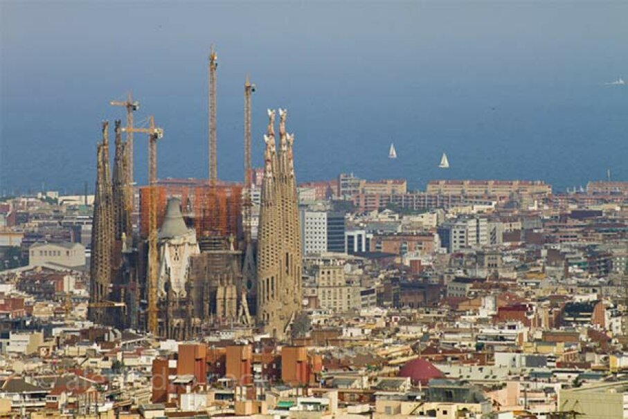The Sagrada Familia cathedral in Barcelona towers over the city. It's been in construction since 1883. alejocock/moment/Getty Images