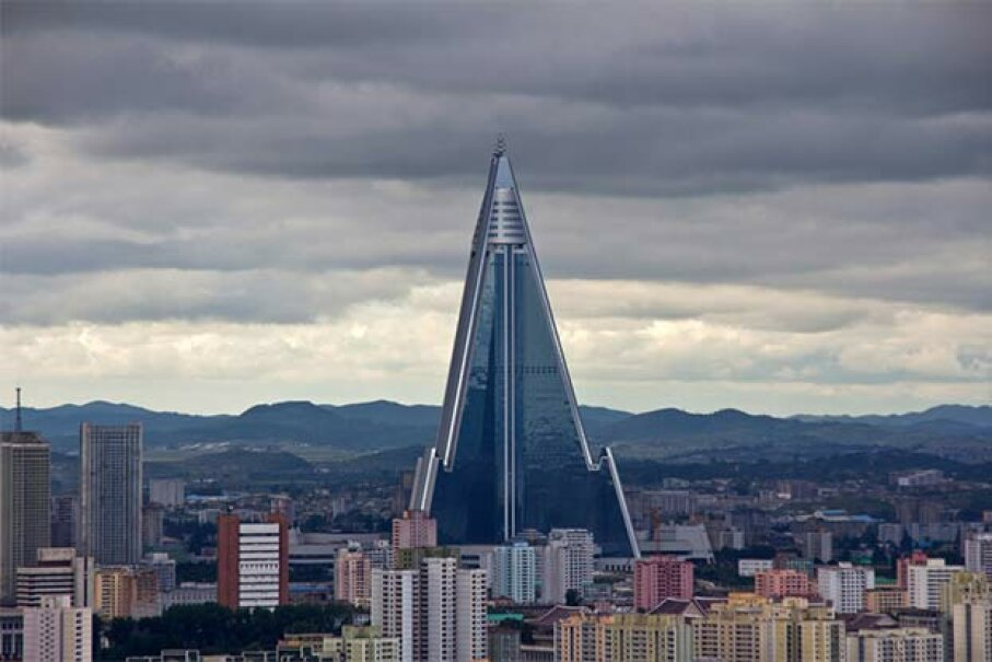 The garish, spaceship-like Ryugyong Hotel is the world's tallest unoccupied building. © Benoit Cappronnier/Moment Open/Getty Images