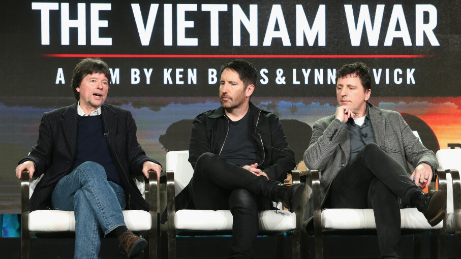 Filmmaker Ken Burns, composer Trent Reznor and composer Atticus Ross of 'The Vietnam War' speak onstage during the PBS portion of the 2017 Winter Television Critics Association Press Tour in Pasadena, California. Frederick M. Brown/Getty Images