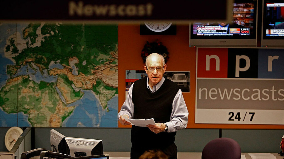 National Public Radio's Carl Kasell organizes news articles while preparing for one of his last newscasts at NPR, Dec. 30, 2009, in Washington, D.C. Chip Somodevilla/Getty Images
