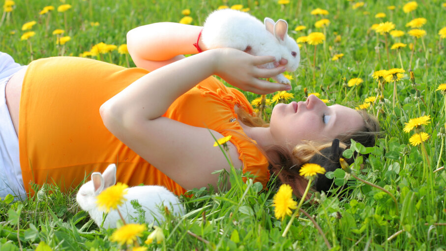 Pregnant woman with rabbit