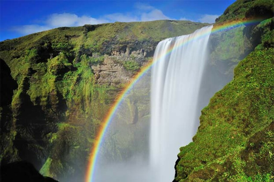 The scenic Skogafoss falls in south Iceland are enhanced with a beautiful rainbow. Why do we love rainbows so much? Nora Carol Photography/Getty Images