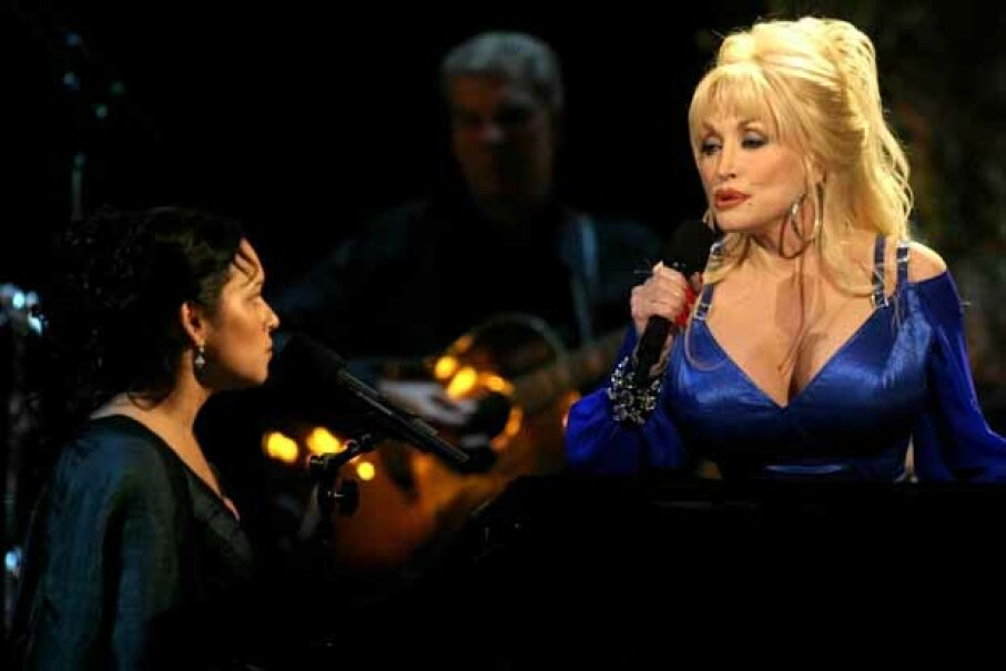 Dolly Parton sings a duet with Norah Jones who appears to be overawed by her singing partner's magnificent chest. © TAMI CHAPPELL/Reuters/Corbis