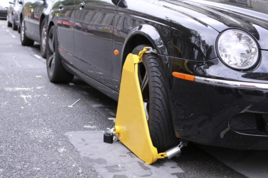 If you find your car clamped, your only hope (outside of paying the associated fees) may be Angle Grinder Man. ©iStockphoto/Ben185