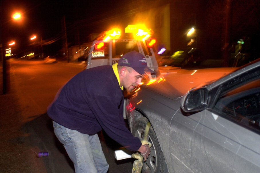 Recovery specialist Rob Sparks of Metropolitan Asset Recovery Solutions, works to reposess a vehicle in Gibbstown, N.J. William Thomas Cain/Getty Images