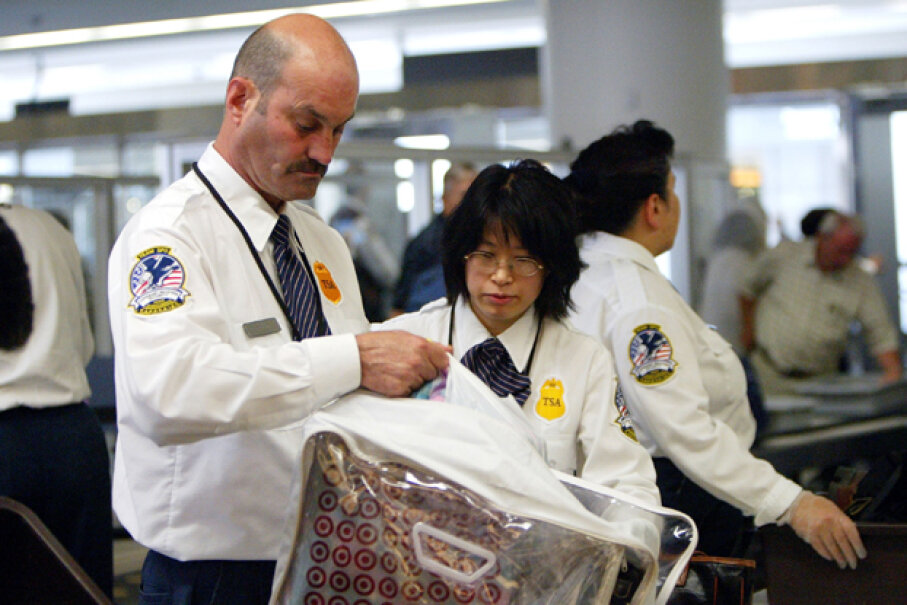 A Transportation Security Administration (TSA) screener inspects a bag at the San Francisco International Airport. The Federal government is a very secure place to work, even in recessionary periods. Justin Sullivan/Getty Images