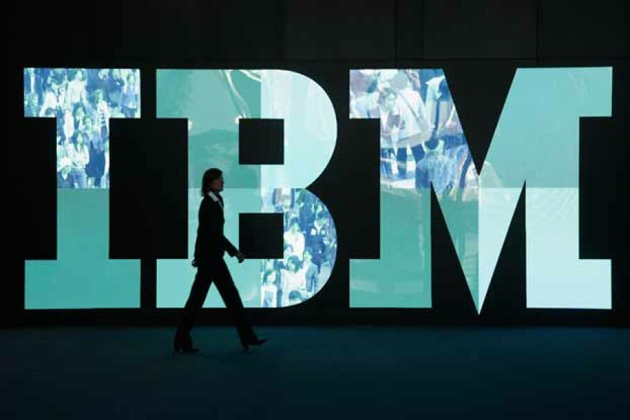 A woman walks past the IBM logo at the 2011 CeBIT technology trade fair in Hanover, Germany. IBM's reinvention is often studied in business schools. Sean Gallup/Getty Images