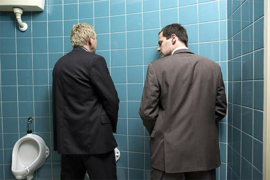 One of the worst places to talk business must be the urinal. Erik Dreyer/The Image Bank/Getty Images