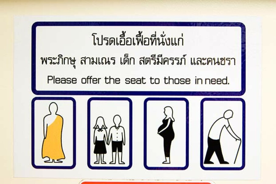 A sign in a train in Bangkok, Thailand reminds riders to give priority seating to the elderly, pregnant women -- and monks. Anders Blomqvist/Lonely Planet Images/Getty Images
