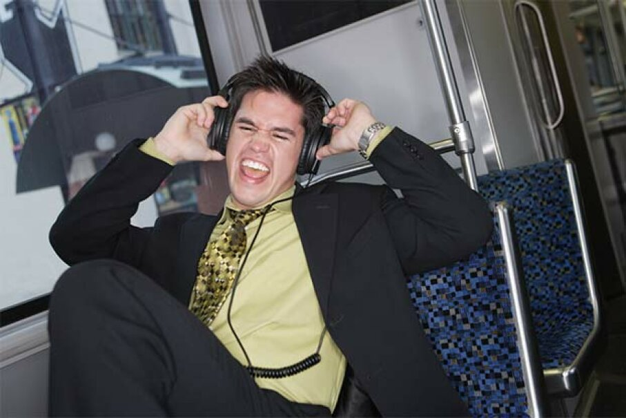 Those tunes you're listening to may be slammin', but that doesn't mean everyone wants to hear them. Stewart Cohen/Jensen Walker/Blend Images/ Thinkstock