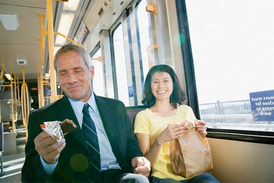 If you're going to eat en route, bring something that doesn't smell or crumble. David Buffington/Blend Images/Thinkstock