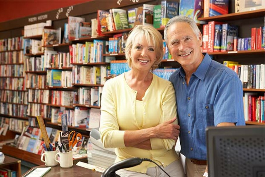 Choosing a Roth 401(k) could mean more money at retirement -- which you could use to start that bookstore you've always wanted to own. monkebusinessimages/Stockbroker/Thinkstock