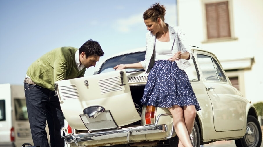 woman and man inspecting car