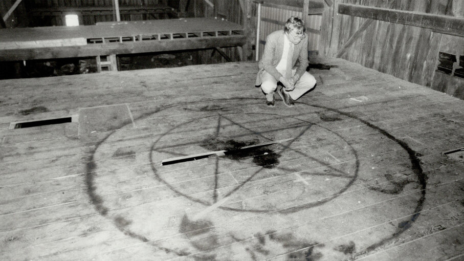 A Star reporter examines a pentagram painted on the floor of a barn loft, 1964, after rumors of a Satanic cult erupted in an Ontario town. Reg Innell/Toronto Star via Getty Images