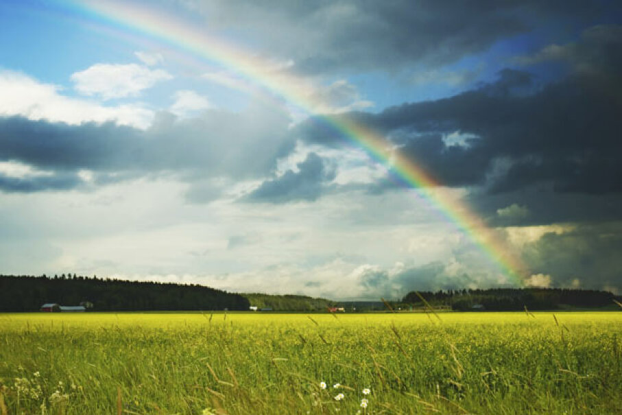 Seeing these blue skies, bright sun and rainbow might make you think of a whole bunch of science questions you can't answer right now. Read on for the solutions. iStockphoto/Thinkstock
