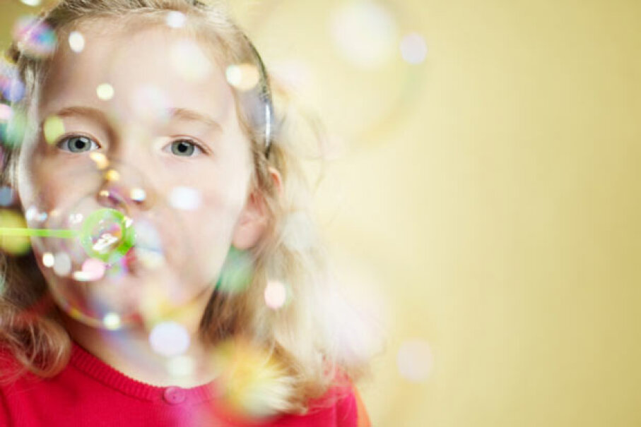 Bubbles are round because they want to be -- thanks to cohesion. Ryan McVay/Getty Images