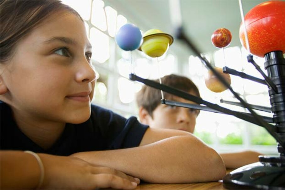 A physical model of the solar system is a way to demonstrate how the planets orbit the sun, while a mathematical model is a set of equations that represents a system. Fuse/Thinkstock