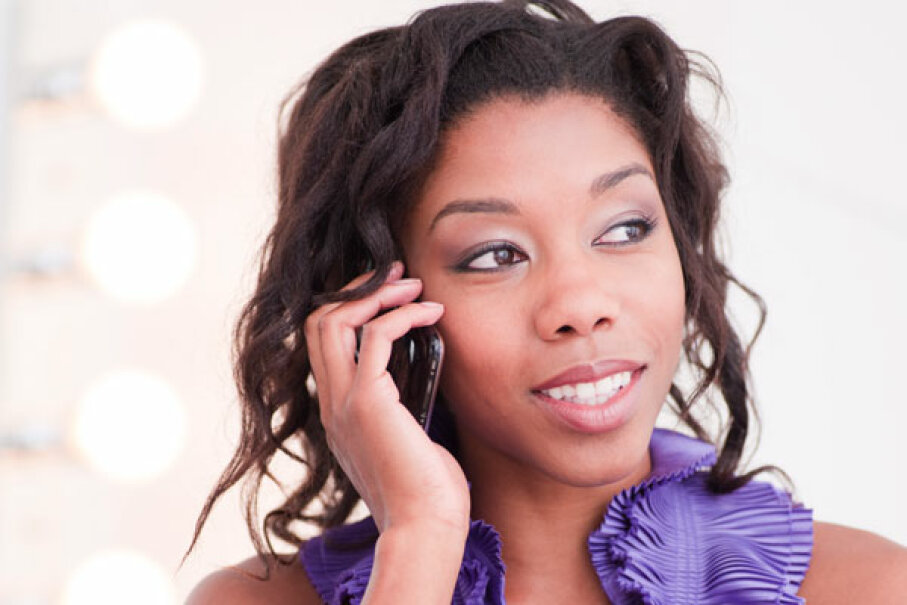African-American woman on cell phone David Roth/Getty Images